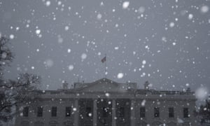 A steady snow falls at the White House in Washington on Tuesday.