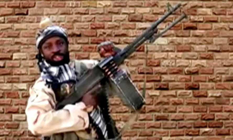 The Boko Haram leader, Abubakar Shekau, holds a weapon in an unknown location in Nigeria a still image taken from an undated video obtained in January 2018