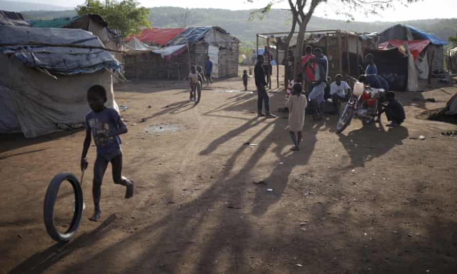 A young boy playing in a refugee camp for Haitians returning from the Dominican Republic