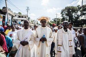 Catholic faithful demonstrate in a silent and non-violent march in Port-au-Prince against the Haitian government on 22 October 2019