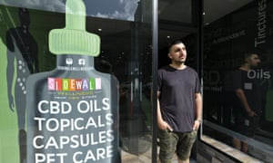 Gus Dabais stands outside his Sidewalk Wellness store in San Francisco, where CBD oil-infused products are popular items.