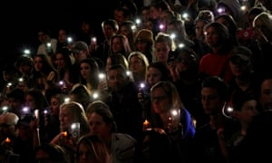 A moment of silence during a vigil for the victims.