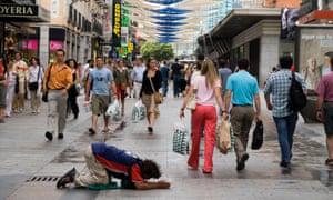 A man begging in Calle de Preciados in Madrid