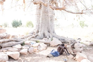 Baba Agunua has been chained to the root of a baobab tree in Zorko village for three years.