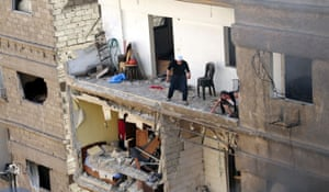 Residents of a building damaged by a car bomb in Jaramana, greater Damascus.