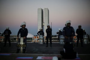 Brasilia, Brazil Riot police guard the National Congress during a vote on whether President Michel Temer should stand trial for corruption. The decision went in his favour