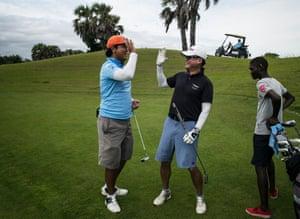 Businessmen enjoy a round of golf at the Mangais golf resort