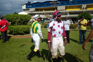 Jockeys Leo Miller (left) and Dane Nelson mill around the paddock area before a race