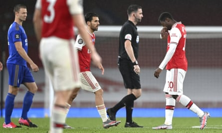 Arsenal's Eddie Nketiah (right) walks off after he was given a red card for a challenge on the Leicester defender Justin James.