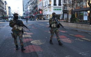 Belgian troops patrol a street in Brussels