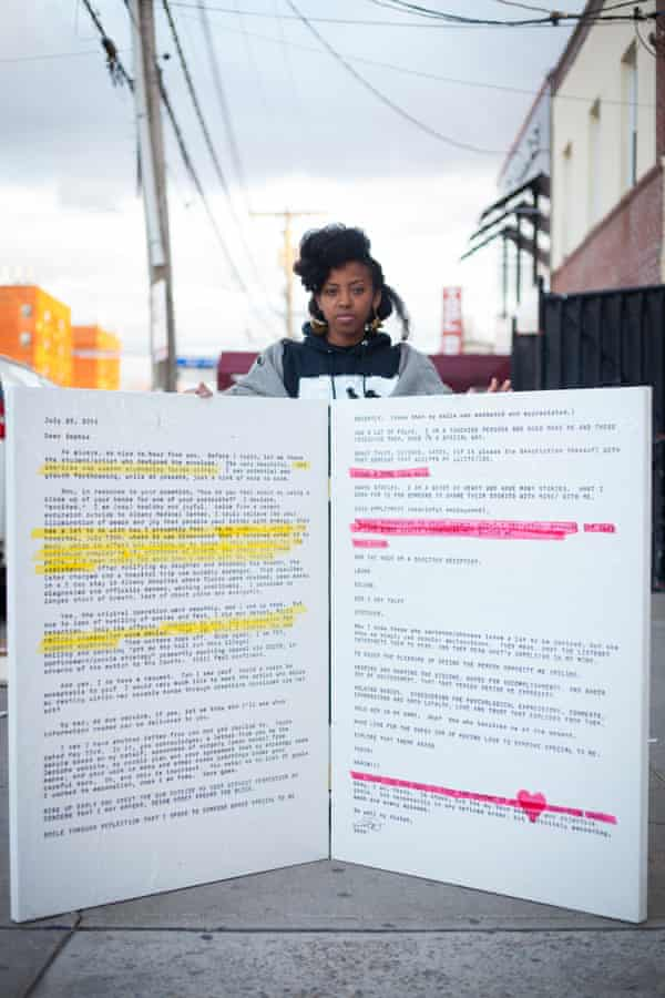 Sophia Dawson and a blown-up image of a letter from one of the political prisoners she has been corresponding with.