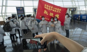 Medical staff drafted in from Yunnan province to tackle the coronavirus outbreak pose for a photo at Wuhan airport.