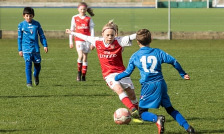 Up for the challenge: the Arsenal Women under-10s team play a match against the AC Finchley boys team.
