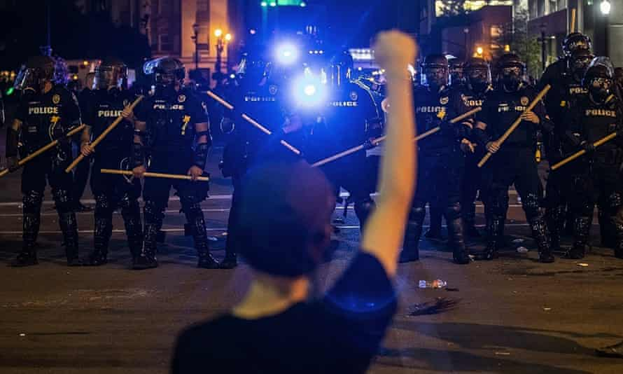 Police hold off protesters in Louisville, Kentucky, on 29 May.