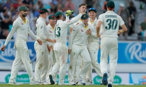 Australia's Steve Smith is congratulated by his teammates after taking a catch to dismiss England's Chris Woakes.