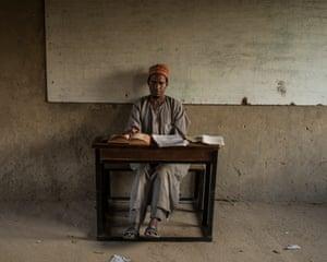 A teacher in the classroom at The Future Prowess Islamic School in the city of Maiduguri, Nigeria