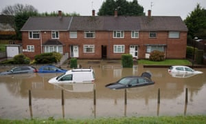 Submerged cars are abandoned in Hartcliffe, Bristol, after Storm Angus