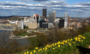 Daffodils grow on Mount Washington overlooking the skyline of downtown Pittsburgh. 'This is a region that's thriving and growing,' says the head of a locally based not-for-profit organization.