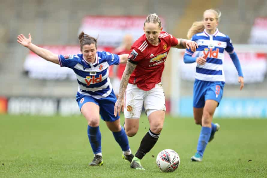 Leah Galton of Manchester United beats Emma Mitchell of Reading.