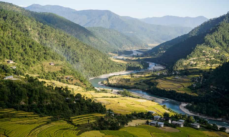 Terraced rice fields and the Mo Chhu river in Punakha, Bhutan.