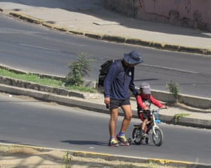 A man and a child enjoy the quiet streets.