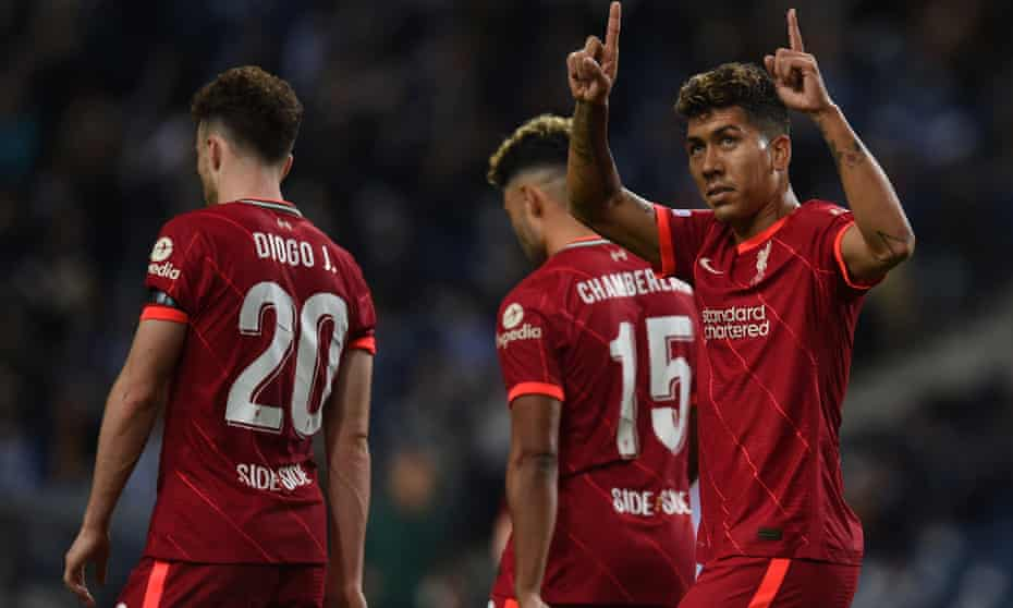Roberto Firmino celebrates scoring Liverpool's fifth goal against Porto and honours Roger Hunt.