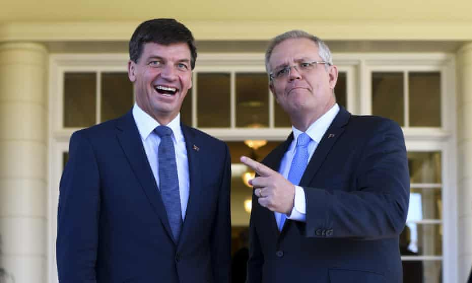 Australian Prime Minister Scott Morrison (right) poses for photographs with Australian Energy Minister Angus Taylor after a swearing-in ceremony at Government House in Canberra, August 28, 2018.