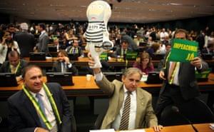 Brazilian opposition deputy raising an inflatable doll