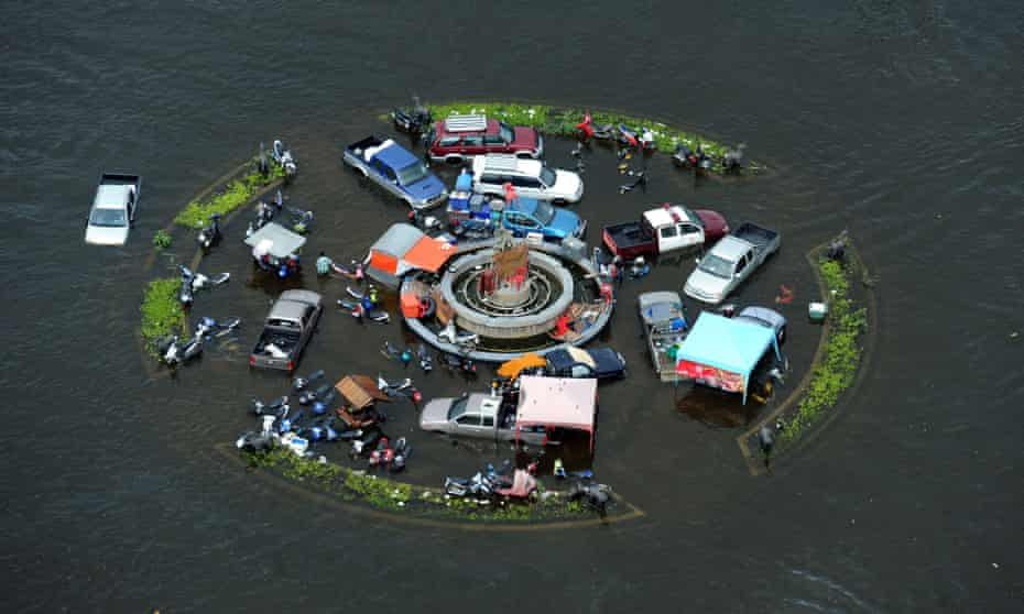 Vehicles are stranded in floodwaters at a roundabout in the ancient city of Ayutthaya, Thailand.