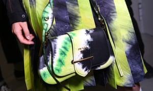 A bright Prada handbag