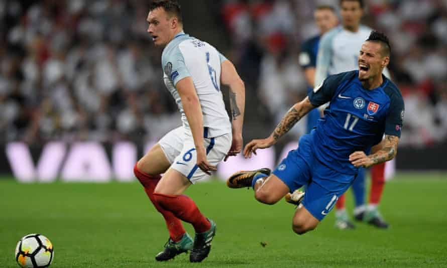 England's Phil Jones challenges Marek Hamsik of Slovakia.