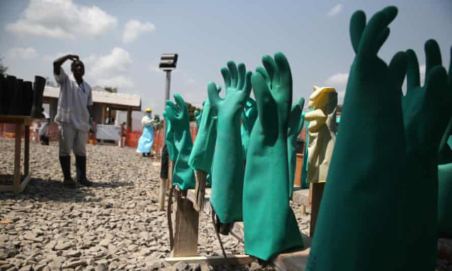 Health workers hang up their gloves as Liberia announces infections have plummeted to the single digits.