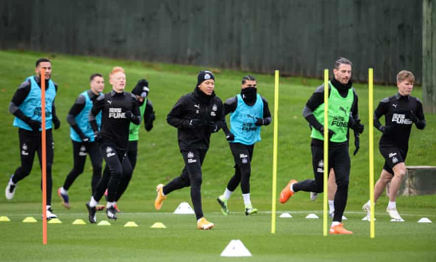 Newcastle players at training on 25 November. The club said they would train again on Tuesday after a period when the facility was shut.
