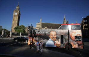 A bus advertising a film about former British prime minister Tony Blair is driven near the Houses of Parliament in London