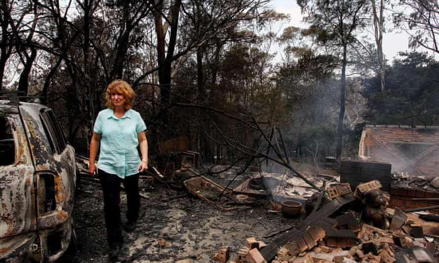 Leanne Brow inspects the remains of her home in Winmalee, New South Waales, following severe bush fires in October 2013, one of Australia's hottest springs on record.
