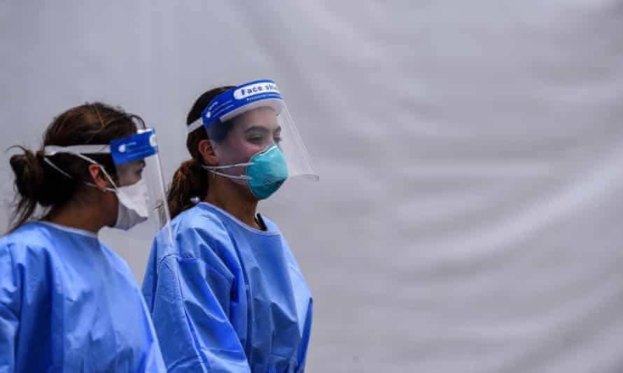 Medical staff wear personal protective equipment at the Hard Rock stadium in Miami Gardens, Florida, on 5 August.