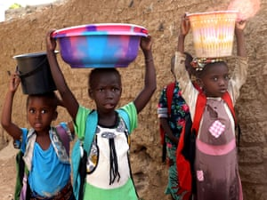 Bamako, MaliChildren help out with domestic chores. Despite all the negativities, kids can manage to smile in Mali where Half of the population is between the ages of 0-14