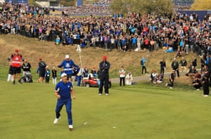 Jon Rahm of Europe celebrates winning his match