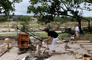 A resident of Corpus Christi picks through her possessions after her home was washed away.