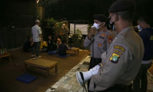 The joint covid-19 supervisory officer makes an appeal to residents who gathered and places of culinary business around the Duren Sawit area, East Jakarta, Indonesia. It was carried out due to the case of the transmission of Covid-19 increased and tightened all activities were limited to 9pm.