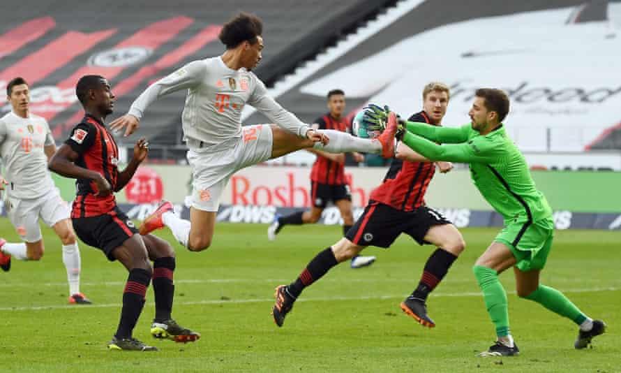 Bayern Munich's Leroy Sané is denied by Eintracht Frankfurt's goalkeeper Kevin Trapp.
