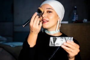A model applies makeup backstage at the Mod Markit show