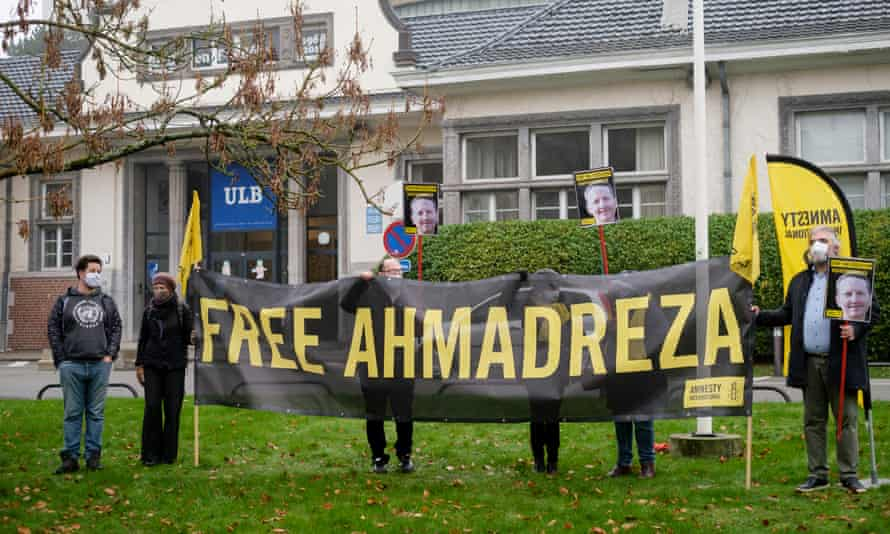 Protesters hold a banner reading 'Free Ahmadreza'