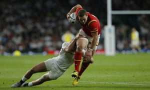 George North is hauled back