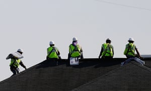 In this Wednesday, March 23, 2016, photo, construction workers rest while unloading supplies off a hoisted pallet on a rooftop in Atlanta. On Wednesday, May 4, 2016, the Institute for Supply Management, a trade group of purchasing managers, issues its index of non-manufacturing activity for April. (AP Photo/David Goldman)