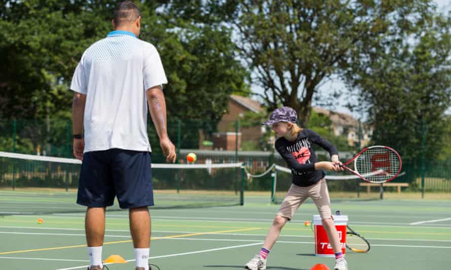 Children's tennis coaching session