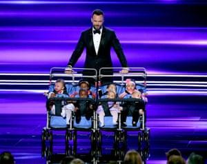 Host Joel McHale with children in a stroller