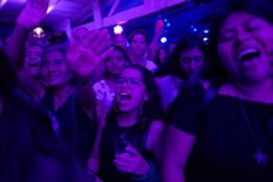 Female audience members sing along at a Rebeca Lane gig
