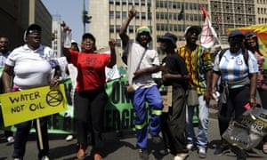 Climate protesters demonstrate outside the local government legislature's offices in Johannesburg, South Africa