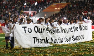 The Japanese team hold a banner after winning the 2011 Women's World Cup final.